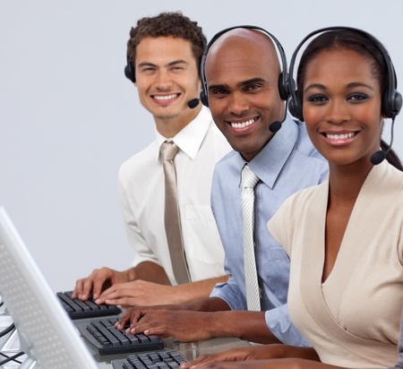 Enthusiastic business partners with headset on  photo