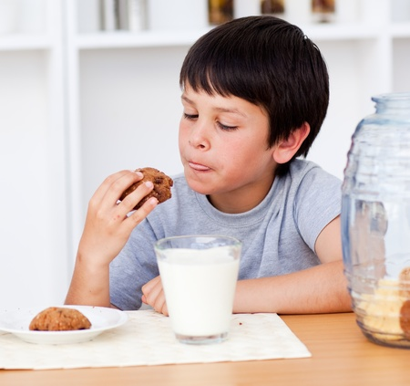 Young boy eating biscuits photo