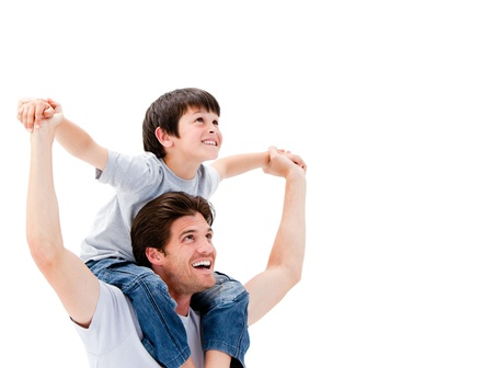 parents: Father giving a piggyback to his son Stock Photo
