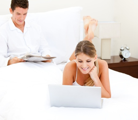 Cute couple surfing on the internet Stock Photo - 10245880