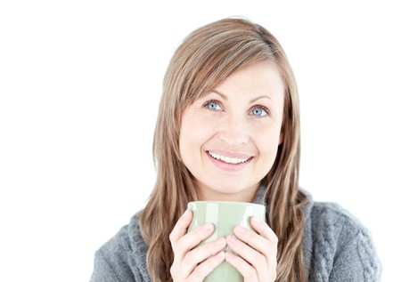 Joyful woman holding a cup a coffee Stock Photo - 10249306