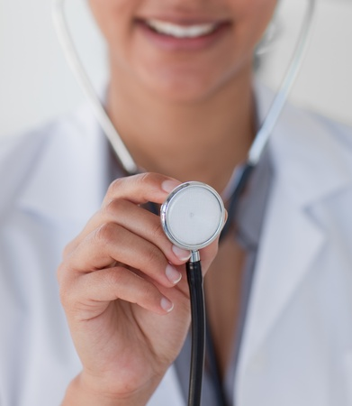 Close-up of a doctor holding a stethoscope photo
