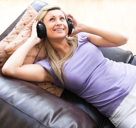 Happy woman using headphones Stock Photo - 10245908