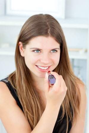 Portrait of a beautiful woman use gloss looking in the camera Stock Photo - 10245924