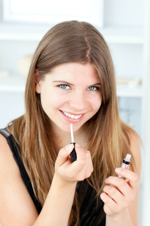 Charming woman holding lipstick in the camera Stock Photo - 10245984