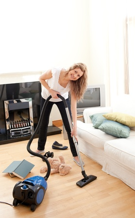 Handsome woman cleaning her living room photo