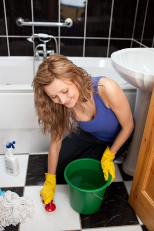 cleansed: Yound woman sitting on the ground in a bathroom