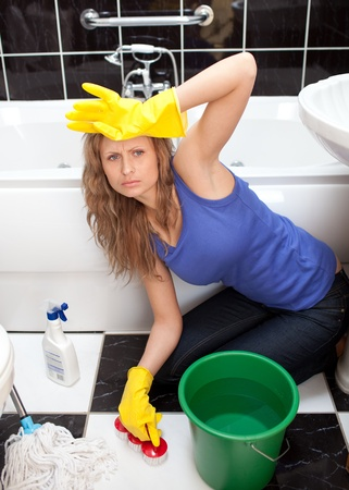 disconsolate: Exhausted woman in a bathroom Stock Photo