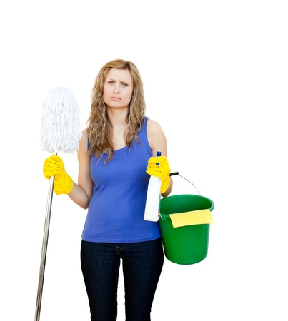 afflict: Portrait of a delighted woman doing the housework