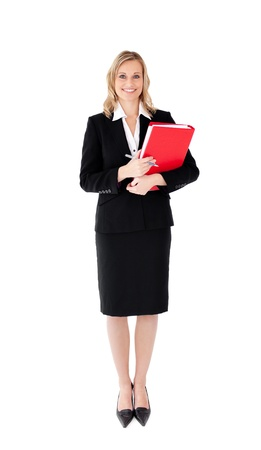 Attractive businesswoman with a pen and a folder against white background photo