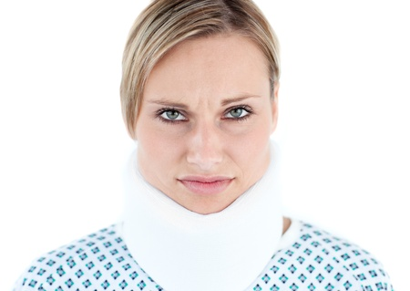 feeble: Serious female patient against a white background