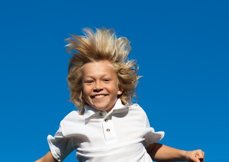 Young Kid Jumping in the air outdoor  photo