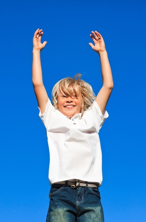Joyful Kid Jumping in the air outdoor  photo