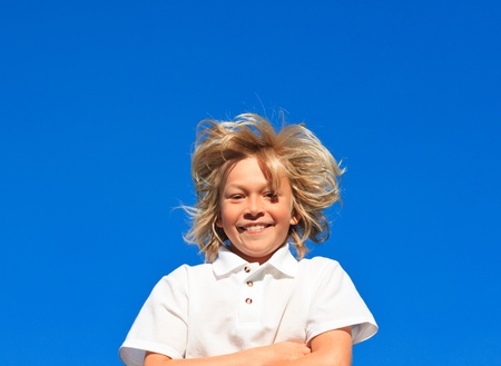 Smiling Kid with arms folded having fun outdoor  photo