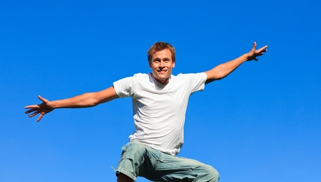 Cute Man jumping in the air outdoor photo