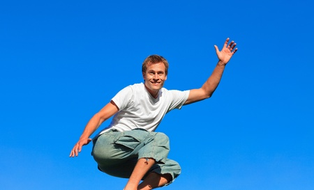 Confident Man jumping in the air outdoor photo