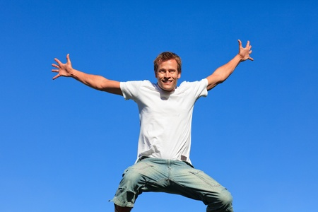 Portrait of a Young Man jumping in the air outdoor photo