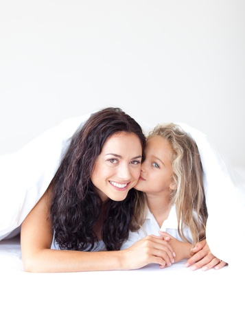 Happy girl kissing her smiling mother Stock Photo - 10233812