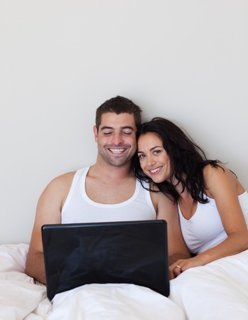 Jolly couple lying in the bed  photo