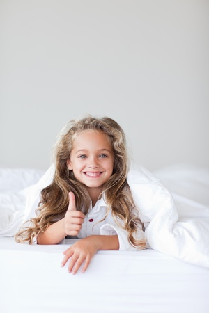Delighted little girl against white background photo