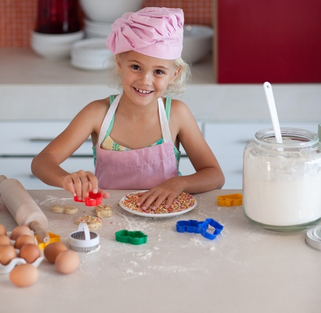 Cute girl baking cookies photo