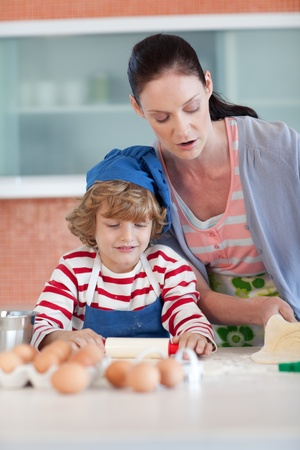 Brunette woman baking with a little boy photo