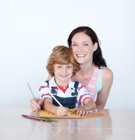 Mother and son writing at home  photo