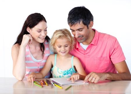 Vader en moeder trekken met haar dochter Stockfoto