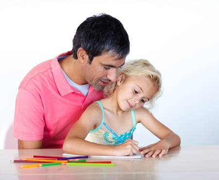 Father helping his cute daughter to draw a picture photo