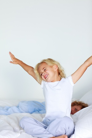 Tired girl stretching on the bed Stock Photo - 10246493