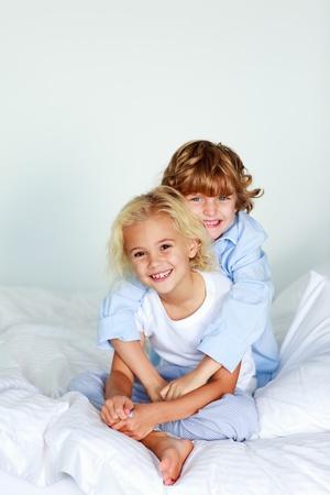 Siblings hugging photo