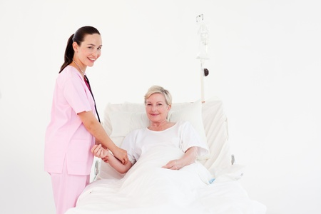 Young nurse helping a senior patient  photo