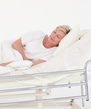 Elderly patient in white bed photo