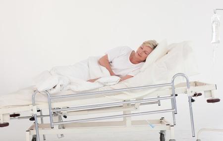 Tired elderly patient Stock Photo