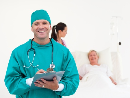 doctors tools: Handsome surgeon smiling at the camera Stock Photo