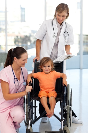 Baby girl sitting in a wheelchair photo