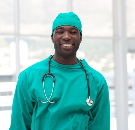 Portrait of a smiling doctor in green scrubs photo