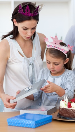 chirpy: Little girl opening Birthday gifts Stock Photo