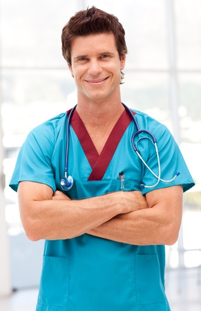 Young confident doctor looking at camera  photo
