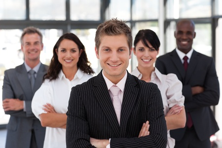 buisinessman: Cute business team looking at the camera