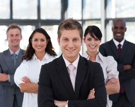 buisinessman: Happy business team looking at the camera Stock Photo