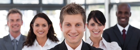 buisinessman: Joyful business team looking at the camera Stock Photo