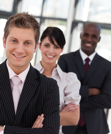 buisinessman: Cheerful business team looking at the camera Stock Photo