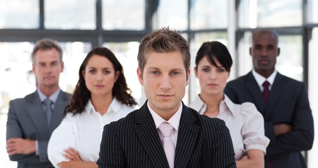 buisinessman: Portrait of a serious business team looking at the camera