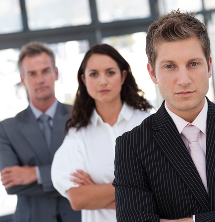 buisinessman: Portrait of a relaxed business team looking at the camera