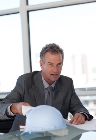 Caucasian businessman working at his desk  photo