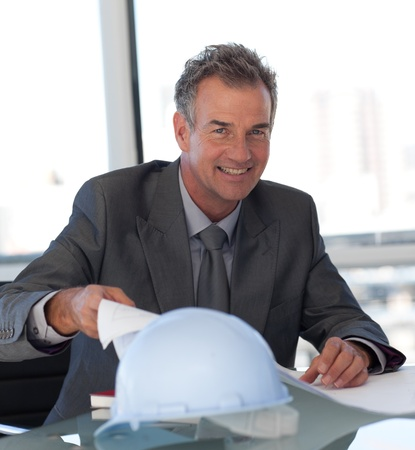 Happy businessman working at his desk  photo