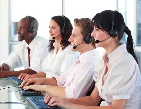 Portrait of a multi-ethnic sale representative team at work Stock Photo - 10247314