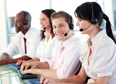 computer centre: Portrait of a happy multi-ethnic sale representative team at work  Stock Photo