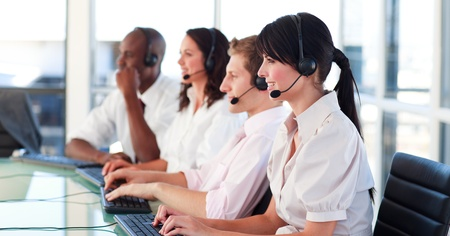 computer center: Portrait of a young multi-ethnic sale representative team at work